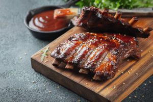 Closeup of pork ribs grilled with BBQ sauce